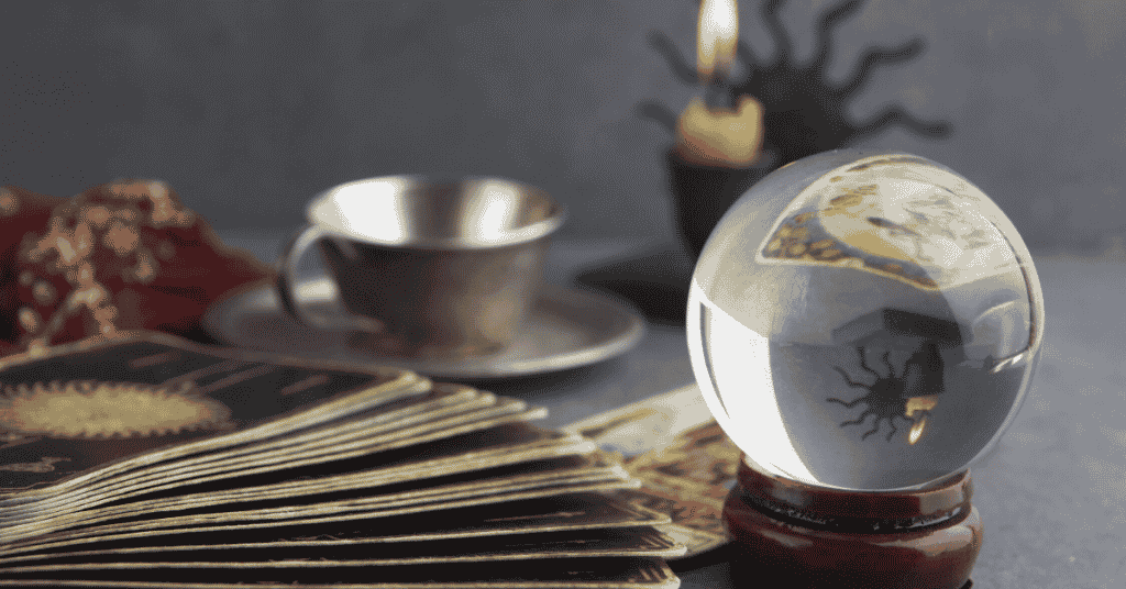 stock picking strategies to avoid. Picture is of a crystal ball, tarot card and a tea cups