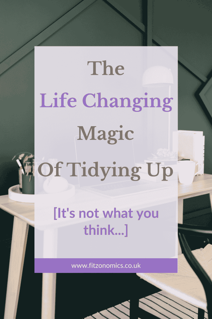 The life changing magic of tidying up it's not what you think title overlay over a picture of a tidy desk